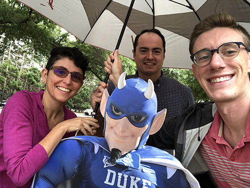The Working@Duke team prepares to cover Hurricane Florence in 2018. L-R: Leanora Minai, Stephen Schramm and Jonathan Black with the office's Blue Devil cardboard cutout.